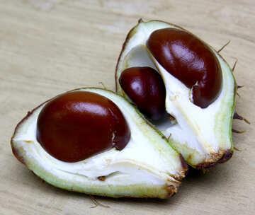 Horse chestnut on wooden background open fruit №46363