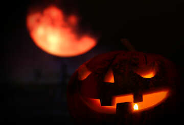 Halloween pumpkin in the background of the moon