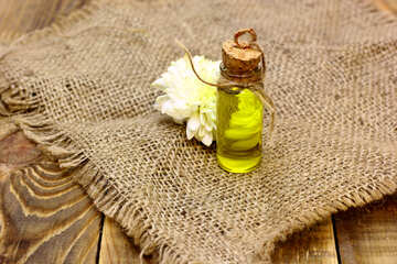 Natural oil background blank with a flower