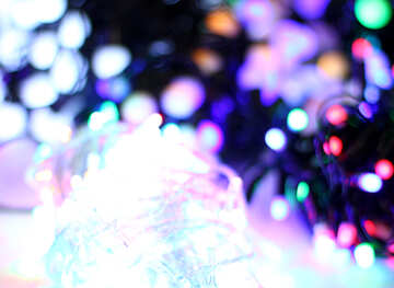 Blurred christmas background background colored lights garlands