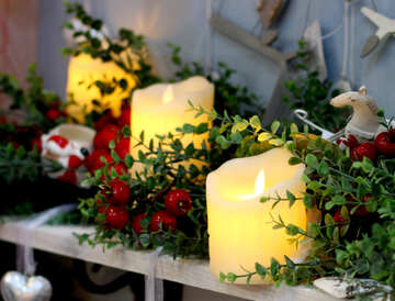 Christmas candles on a table №47629