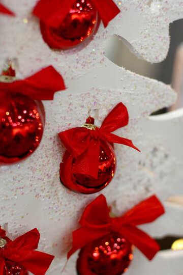 Red Christmas balls on the white Christmas tree №47698