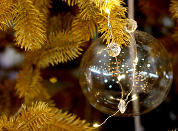 Transparent Christmas toy on a Christmas tree with bulbs №47774