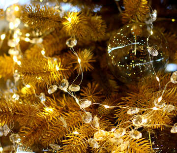 Transparent Christmas toy on a Christmas tree with bulbs №47767
