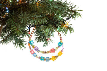 Garland of beads on the tree with Happy New Year and Merry Christmas isolated on white background