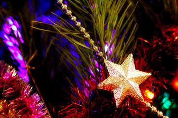 Star garland ornament on a Christmas tree №47939