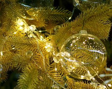 Glass Christmas ball on a branch of a Christmas tree №47714