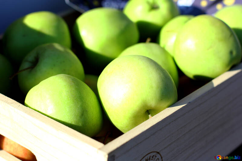 Green apples in a wooden box №47368