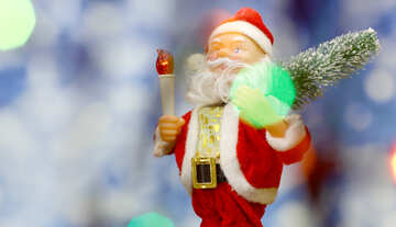 Santa Claus toy brings Christmas tree at blue snowy night bokeh background and blurred lights foreground. Red lantern torch to light the way. Big Copyspace concept New Year`s market banner, poster. №48160