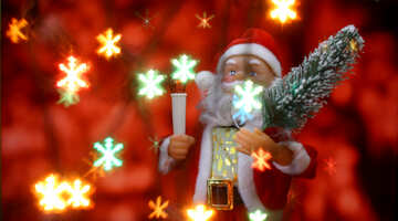 Santa Claus toy brings Christmas tree at glow red bokeh background and blurred lights snowflakes foreground. Big Copyspace concept New Year`s market banner, poster. №48173