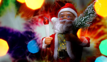 New Year`s card with Santa Claus toy brings Christmas tree at glow sparks bokeh background in the colors of the French flag. №48168
