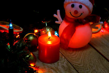 Christmas candle and snowman on a wooden background №48188