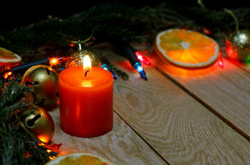 Christmas candle on a wooden background №48186