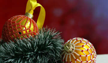Christmas balls decorated with beads on a blurred background №48064