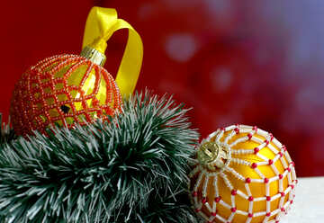 Christmas balls decorated with beads on a blurred background №48065