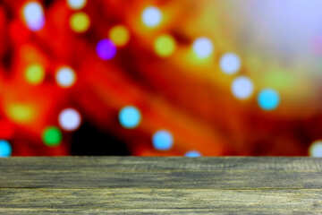 Clean wooden table with blurred background New Year