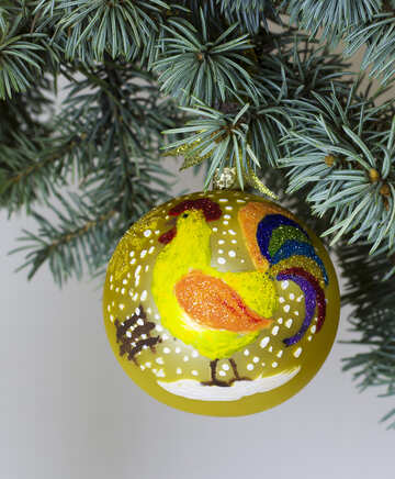 Christmas toy rooster on a branch tree №48185