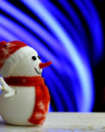 Snowman on a blurred background