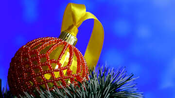 Christmas ball decorated with beads on blue blurred background №48063