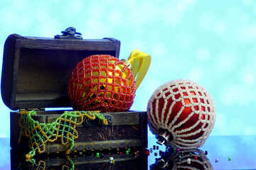 Christmas balls decorated with beads in a wooden box on a blurred background №48054