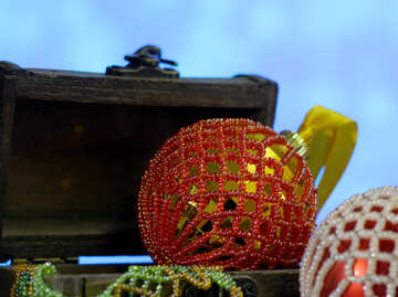 Christmas balls decorated with beads in a wooden box on a blurred background №48055