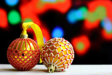 Christmas balls decorated with beads on a blurred background №48060