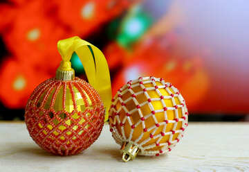 Christmas balls decorated with beads on a blurred background №48061