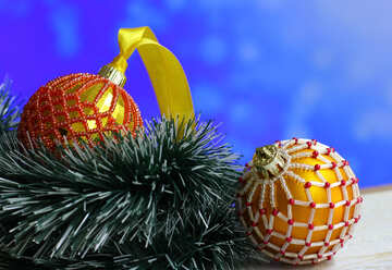 Christmas balls decorated with beads on a blurred background №48062