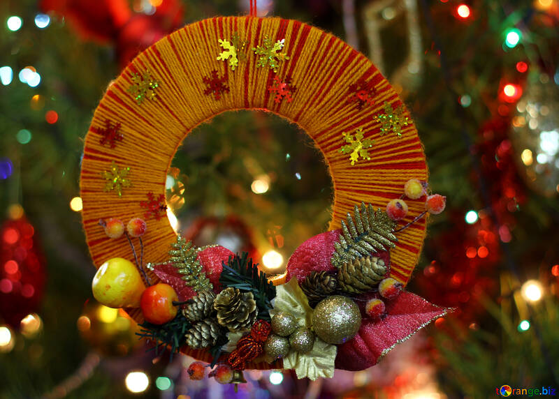 Homemade Christmas wreath on the background of the Christmas tree №48225