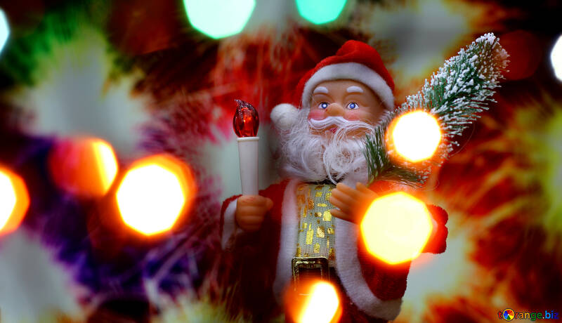 New Year`s card with Santa Claus toy brings Christmas tree at glow sparks bokeh background in the colors of the French flag. Copyspace concept for market banner, poster, congratulations. №48169