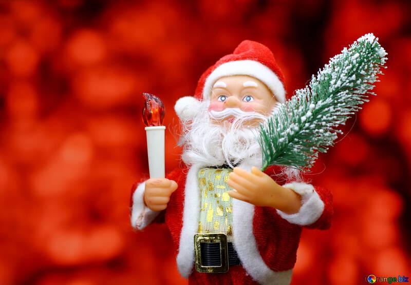 Nueva tarjeta con el juguete del `s de Santa Claus trae árbol de Navidad en el fondo del bokeh resplandor rojo. <font>concepto contexto grande para la bandera mercado de Nueva Year`s, cartel, felicitaciones.</font> №48166