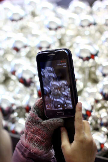 Mobile phone on a background of Christmas decorations №49480