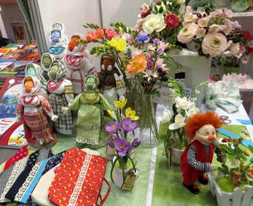 Dolls, trinkets, flowers, gifts, as if at a shrine №49087