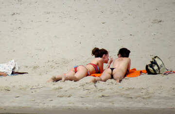 Two girls are sunbathing on the sand №49698