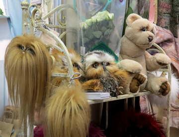 stuffed animals on a white wrought-iron bench hair stuffed №49061