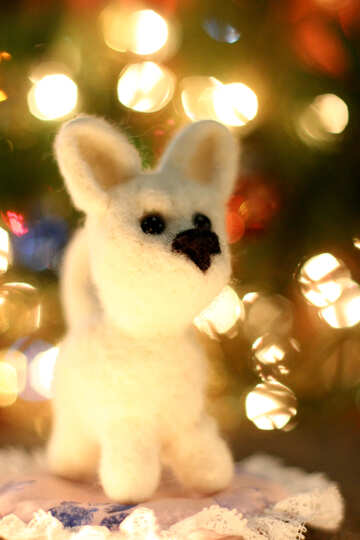 Symbol of new year 2018 white husky dog. New years greetings background. Fancy handmade toy from wool on bokeh Christmas background. Place for insert logo or write text. Copyspace for congratulations. №49641