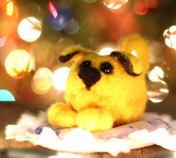 Symbol of new years 2018 yellow mongrel dog. New years greetings background. Fancy handmade toy from wool on bokeh Christmas background. Place for insert logo or write text. Copyspace for congratulations. №49630