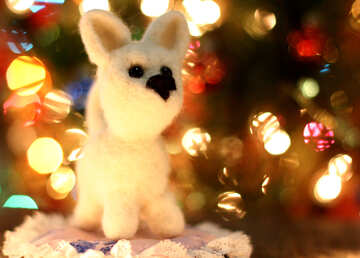 Symbol of new years 2018 white husky dog. New years greetings background. Fancy handmade toy from wool on bokeh Christmas background. Place for insert logo or write text. Copyspace for congratulations. №49640