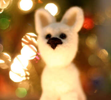 Symbol of new years 2018 white husky dog. New years greetings background. Fancy handmade toy from wool on bokeh Christmas background. Place for insert logo or write text. Copyspace for congratulations. №49645