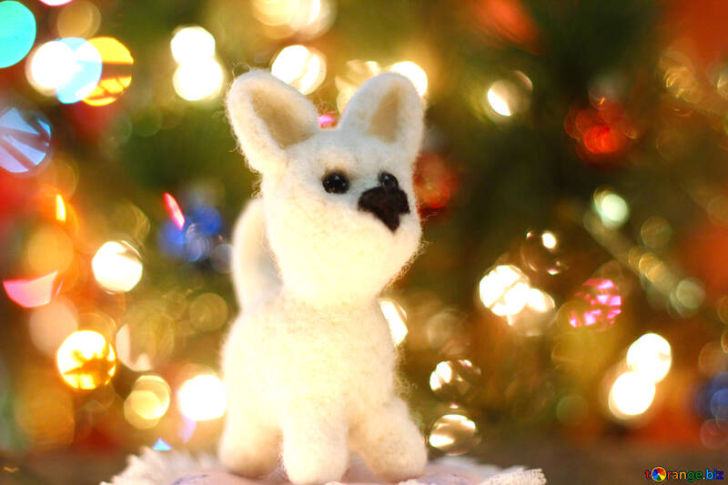 Symbol of new years 2018 white husky dog. New years greetings background. Fancy handmade toy from wool on bokeh Christmas background. Place for insert logo or write text. Copyspace for congratulations. №49638