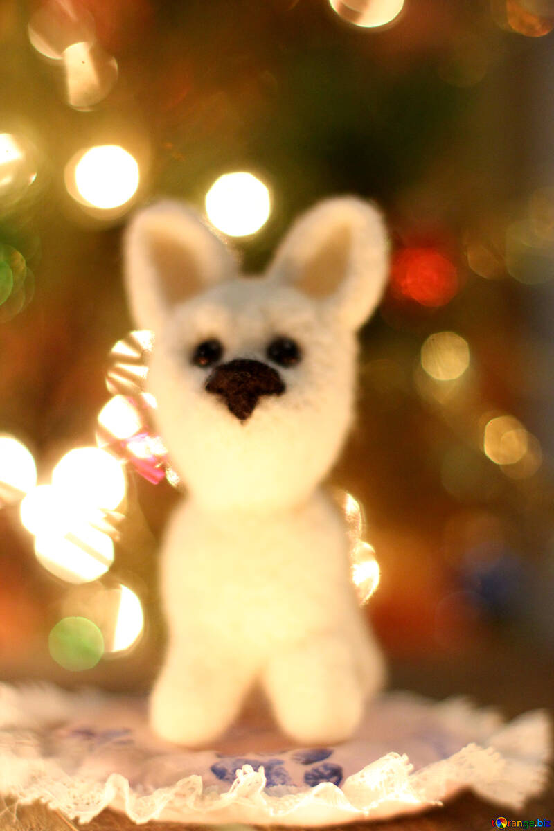 Symbol of new years 2018 white husky dog. New years greetings background. Fancy handmade toy from wool on bokeh Christmas background. Place for insert logo or write text. Copyspace for congratulations. №49643