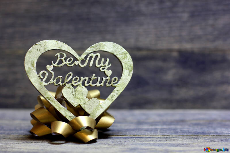 Heart and golden bow on a wooden background №49201