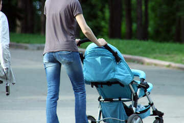 A man walks with baby carriage