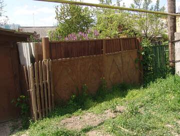 Ingrown rusty iron gate. №5329