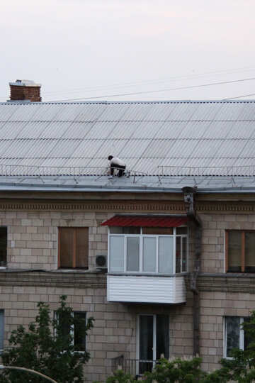 Man on the roof to install dish №5105