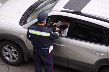 Policeman takes the documents from the driver, law, registration certificate №5227