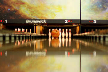 picture of a bowling lane with bowling pins about to be hit by a bowling ball №50451