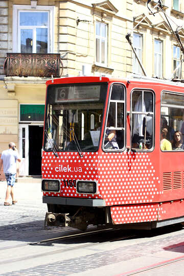 red electric street car in city tram train №51726