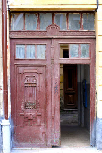 A red door one side open with glass ventilator one closed №51746