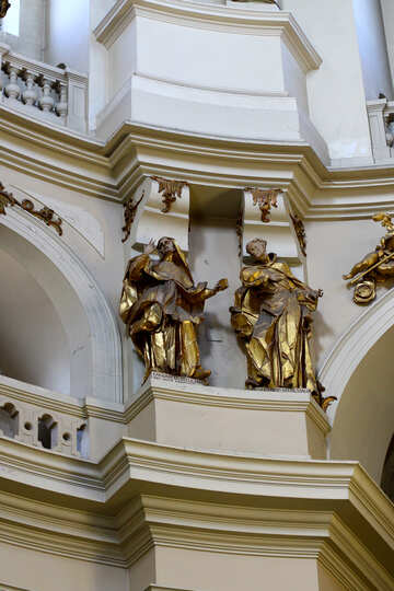 two gold statues architecture palace